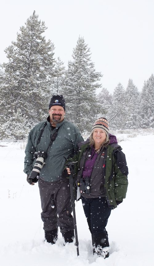 Two very happy birders. Note Great Gray Owl on top of tree at left.
